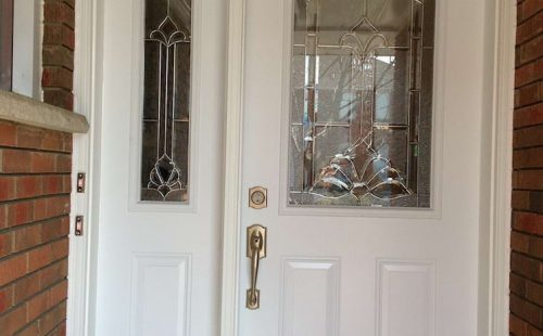 white entry door with side panel