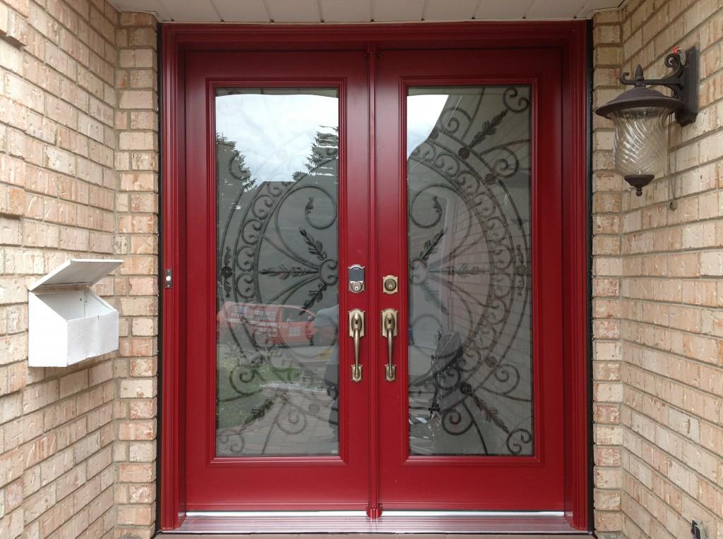 Bright red double front door Canada