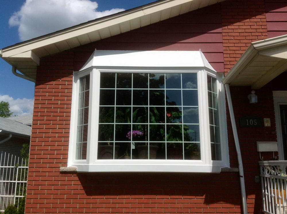 single picture window installation by milano windows & doors