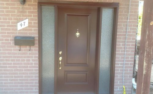 wooden front door with 2 side panels