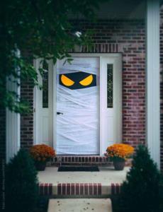 front door decor ideas Spooky Halloween Door Wrapped Up As Mummy by sjlocke
